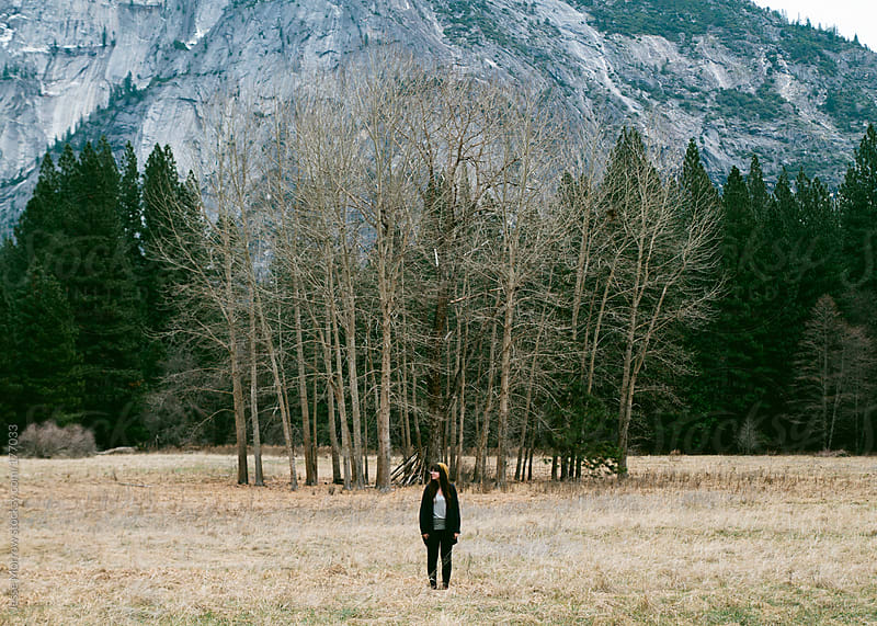 in front of trees by Jesse Morrow for Stocksy United