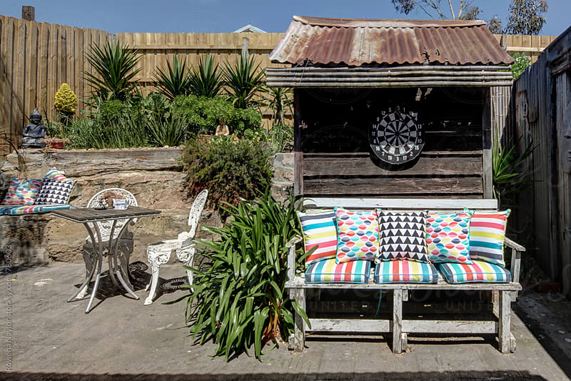 Colorful garden bench seat by Rowena Naylor for Stocksy United