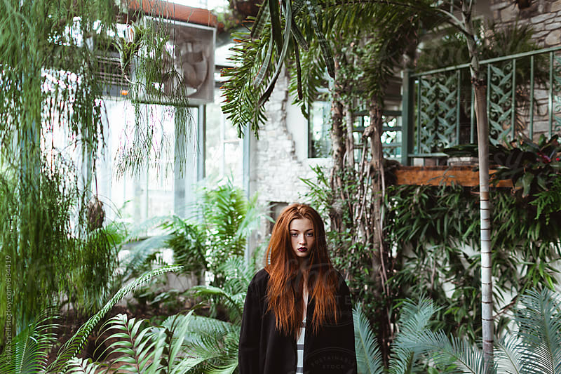 Woman in a greenhouse by Kayla Snell for Stocksy United