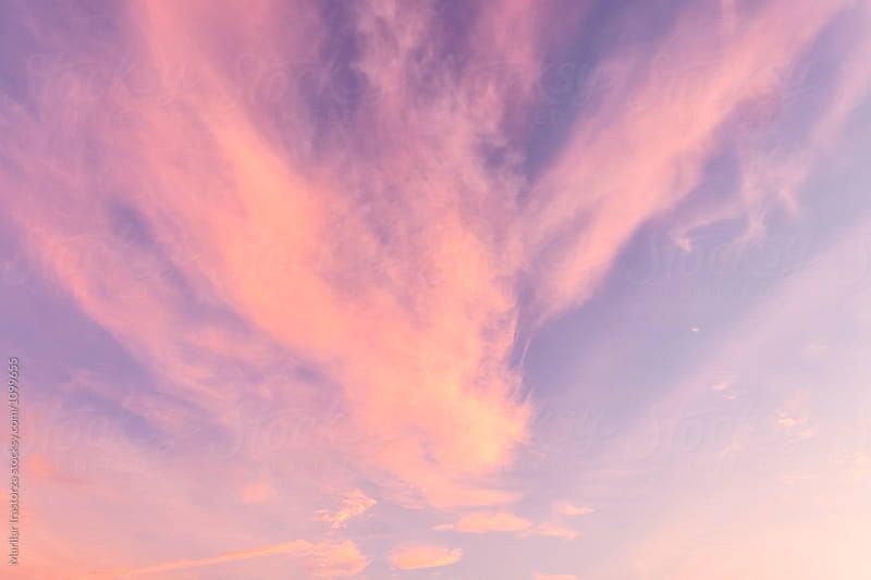 Soft clouds up in the sky during sunset by Marilar Irastorza for Stocksy United