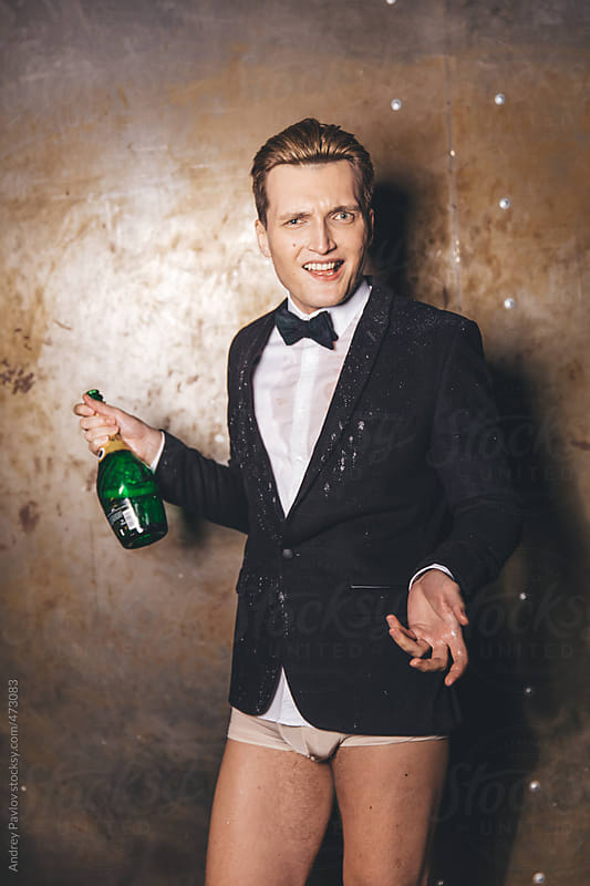 Half-dressed men wet himself with a champagne by Andrey Pavlov for Stocksy United
