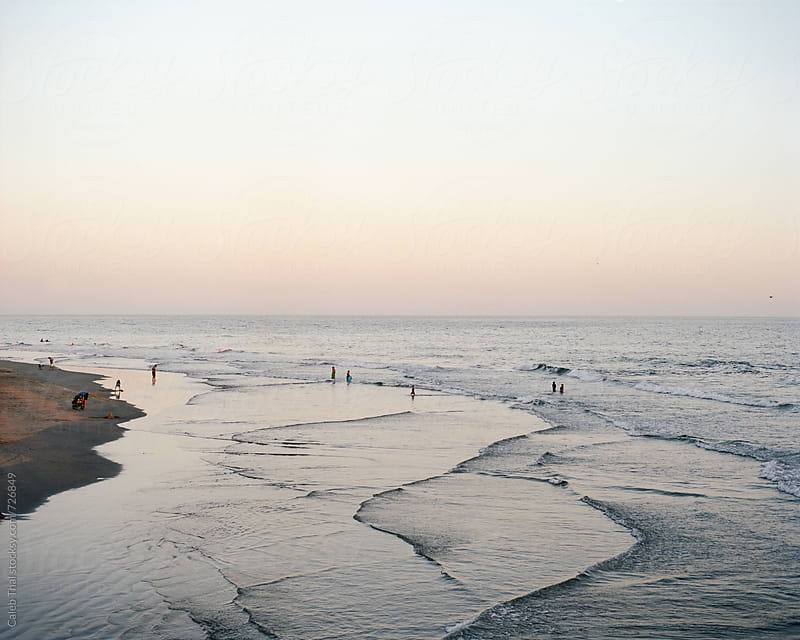 Beach at Sunset by Caleb Thal for Stocksy United