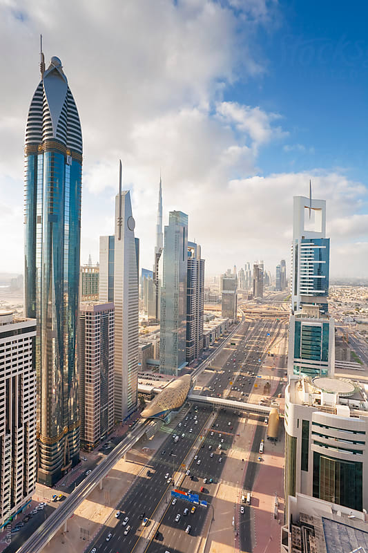 Elevated view over the modern Skyscrapers along Sheikh Zayed Road looking towards the Burj Kalifa, Dubai, United Arab Emirates by Gavin Hellier for Stocksy United