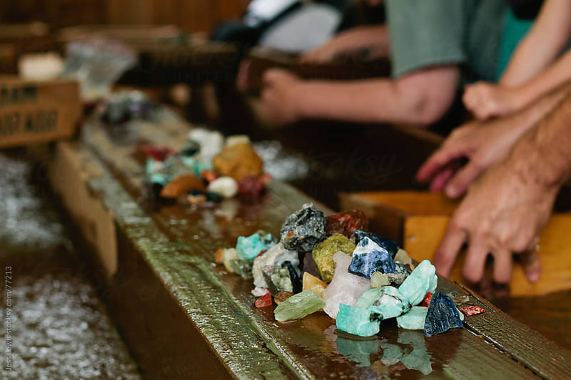 people mining for gemstones by Jess Lewis for Stocksy United
