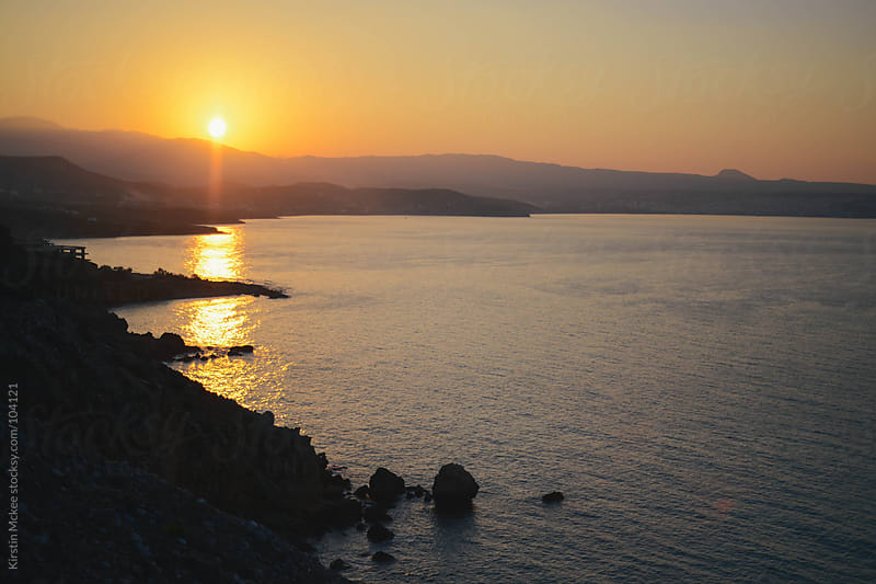 Sunset over the coast of Crete. by Kirstin Mckee for Stocksy United