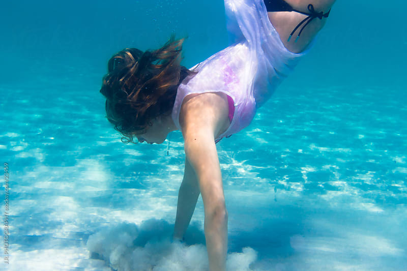 Young girl dive by J.R. PHOTOGRAPHY for Stocksy United