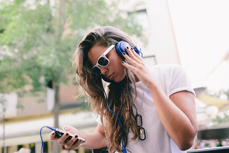 Woman Listen Music with Mobile Phone by HEX. for Stocksy United