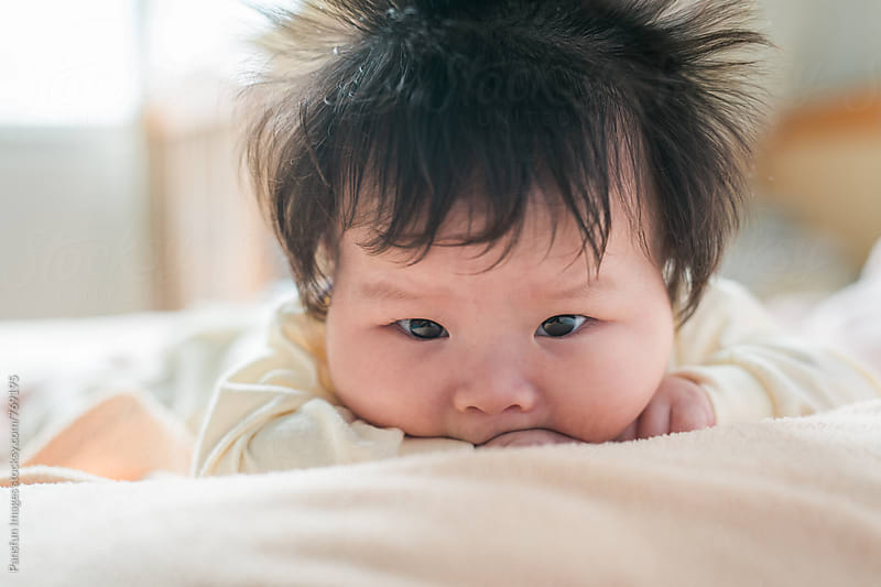 cute baby girl by Xunbin Pan for Stocksy United