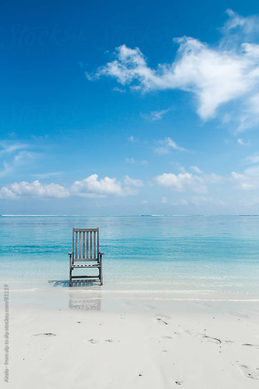 Lonely Chair on a white sanded beach by Leander Nardin for Stocksy United