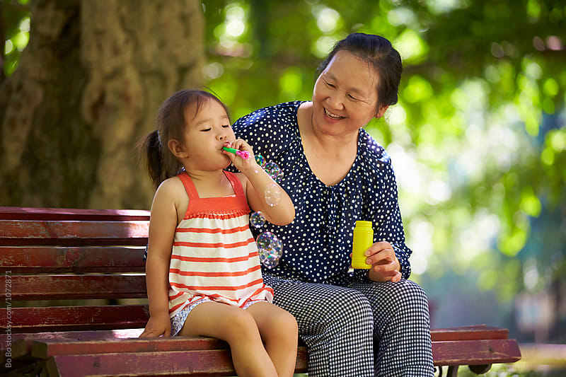 little girl with her grandmother by Bo Bo for Stocksy United