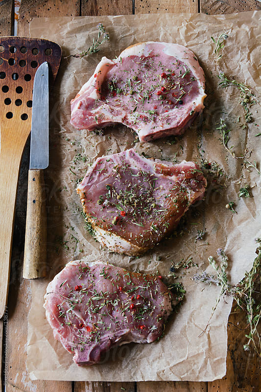 Seasoned raw steaks by Pixel Stories for Stocksy United