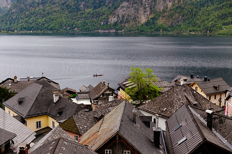 Tiled roofs of autrian village near lake by Andrey Pavlov for Stocksy United