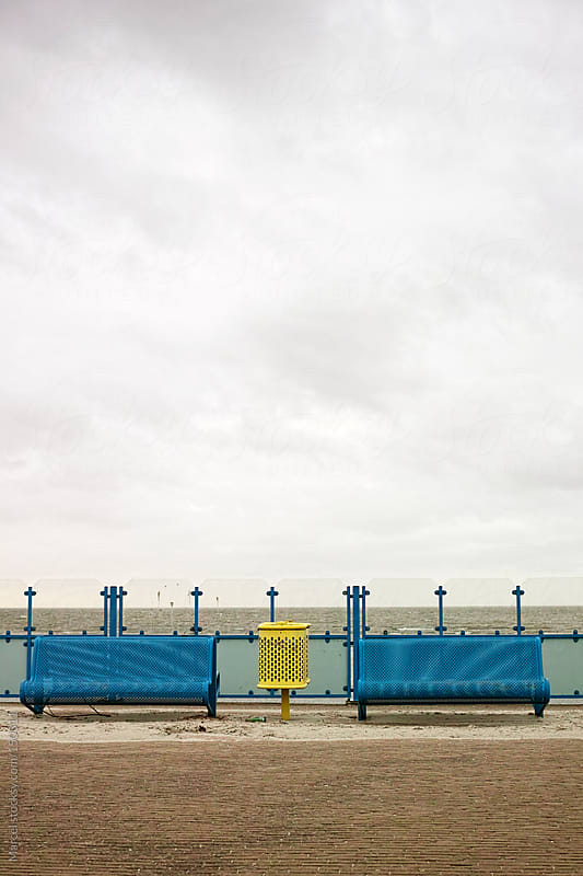 Blue benches at sea by Marcel for Stocksy United