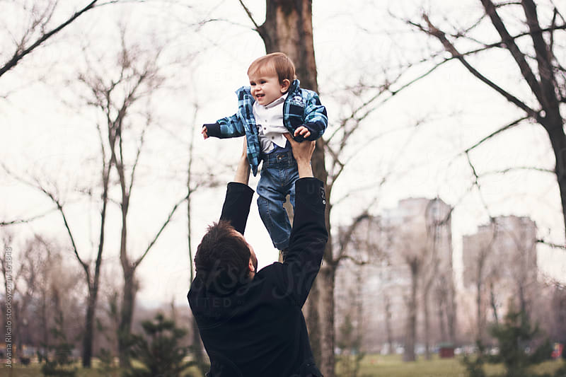Dad throwing baby in the air by Jovana Rikalo for Stocksy United