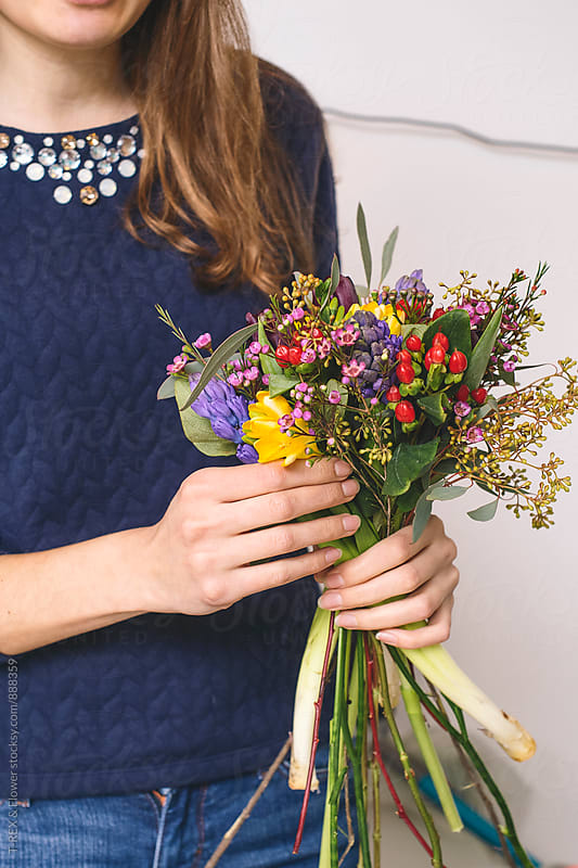 Close-up of woman holding bright arranged bouquet by Danil Nevsky for Stocksy United