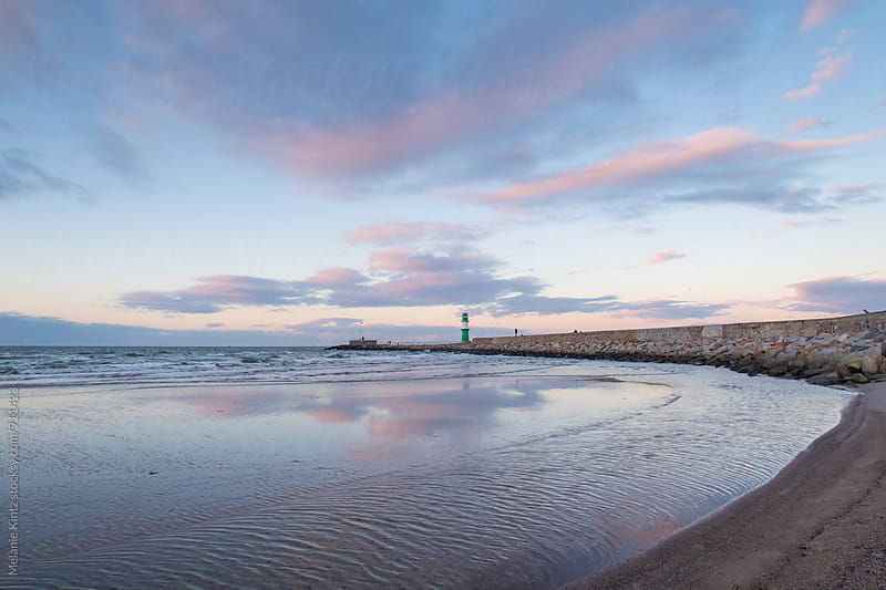 Wide-angle view of Warnemuende's lighthouse at dusk by Melanie Kintz for Stocksy United