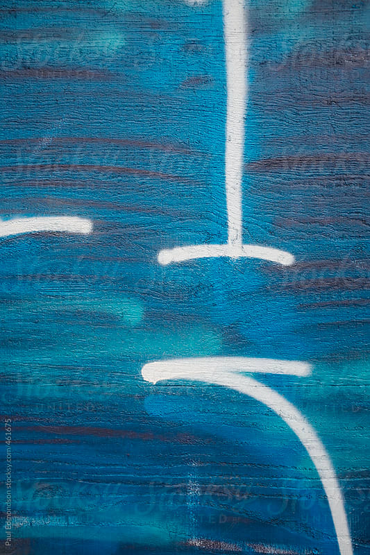 Graffiti tag and spray paint in building wall, close up by Paul Edmondson for Stocksy United