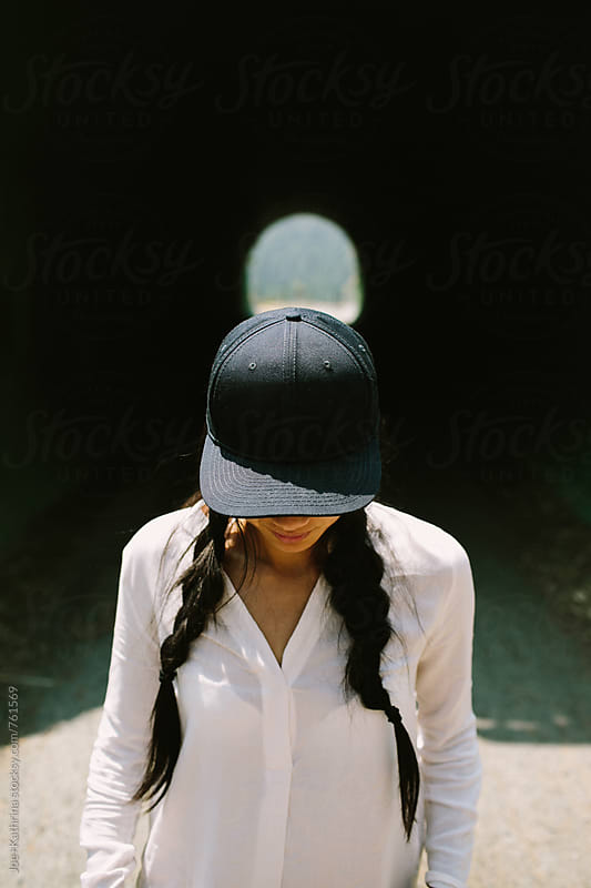 baseball cap + pigtails by Joe+Kathrina for Stocksy United