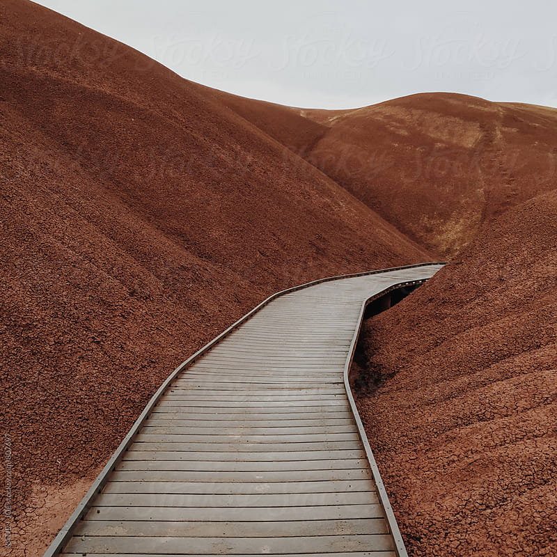 pathway through red clay hills by KATIE + JOE for Stocksy United