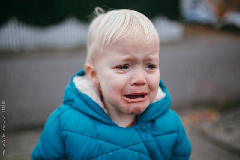 Portrait of a Toddler Boy Crying in his Winter Coat by Amanda Voelker for Stocksy United