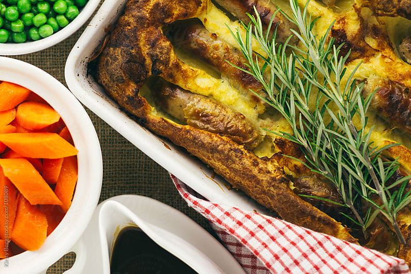 Toad In The Hole from above with rosemary by Kirsty Begg for Stocksy United