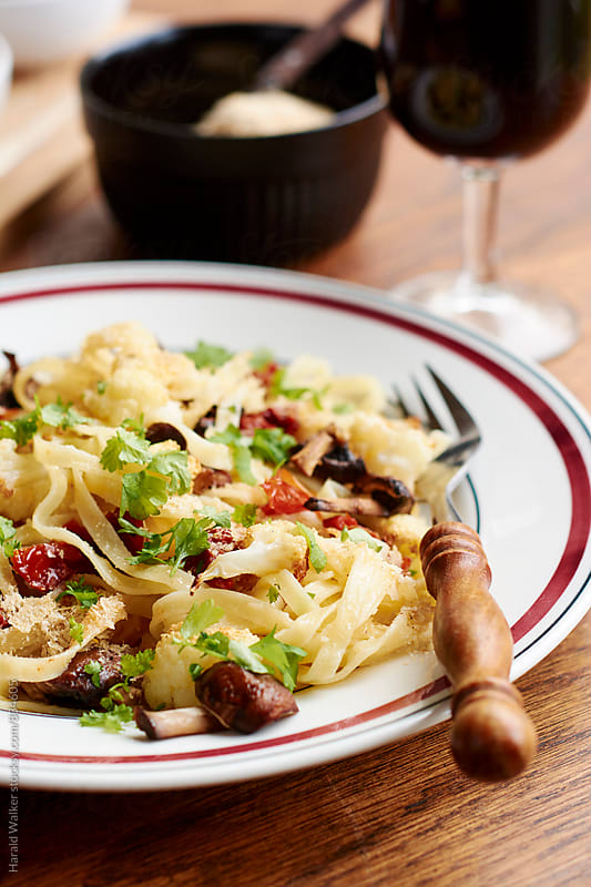 Pasta with Roasted Cauliflower and Mushrooms by Harald Walker for Stocksy United