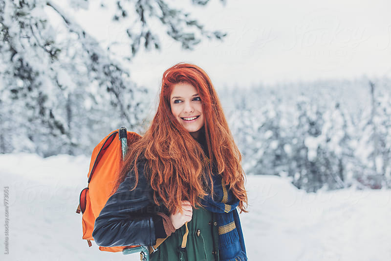 Woman Hiking With an Orange Backpack by Lumina for Stocksy United