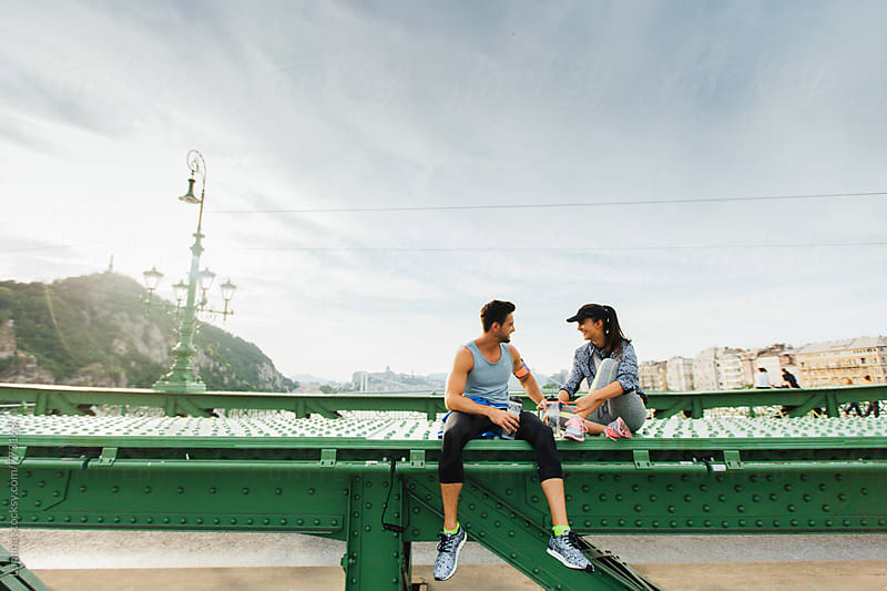Couple in Sportswear Sitting and Chatting  by Lumina for Stocksy United