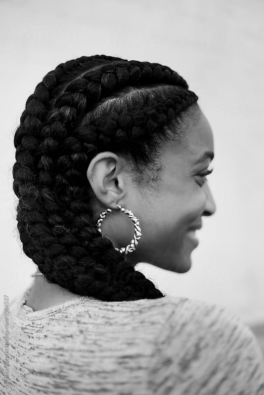 A young african american woman with braided hair by Chelsea Victoria for Stocksy United
