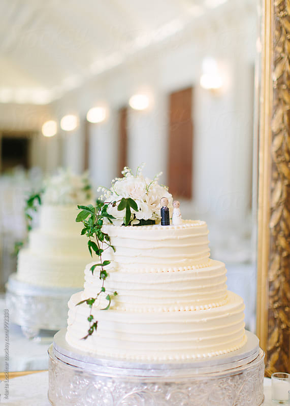 White wedding cake by Marta Locklear for Stocksy United
