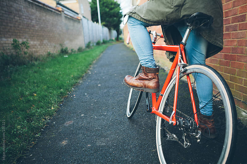 Man cycling in an alley by kkgas for Stocksy United