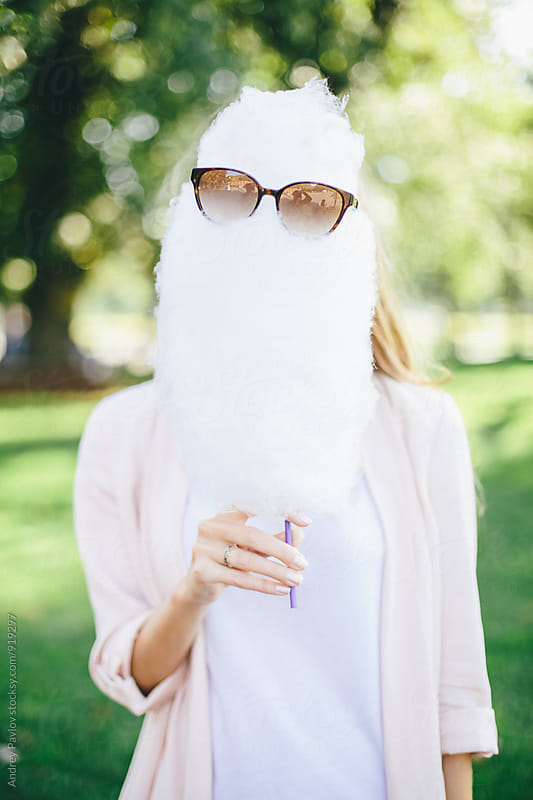 Woman holding candyfloss wearing sunglasses by Andrey Pavlov for Stocksy United