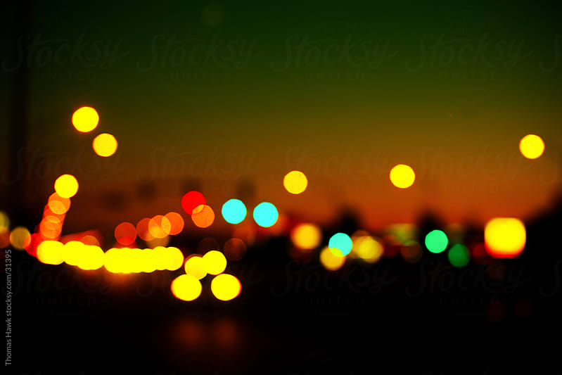 Bokeh car and road at Sunset by Thomas Hawk for Stocksy United