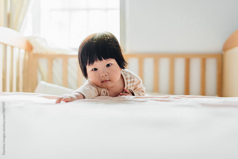 Cute Chinese baby girl by Pansfun Images for Stocksy United