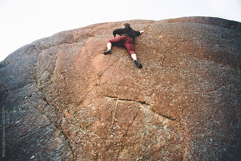 Rock Climber Summits Boulder by Willie Dalton for Stocksy United