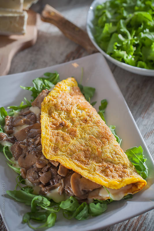 Omelette with mushrooms by Davide Illini for Stocksy United