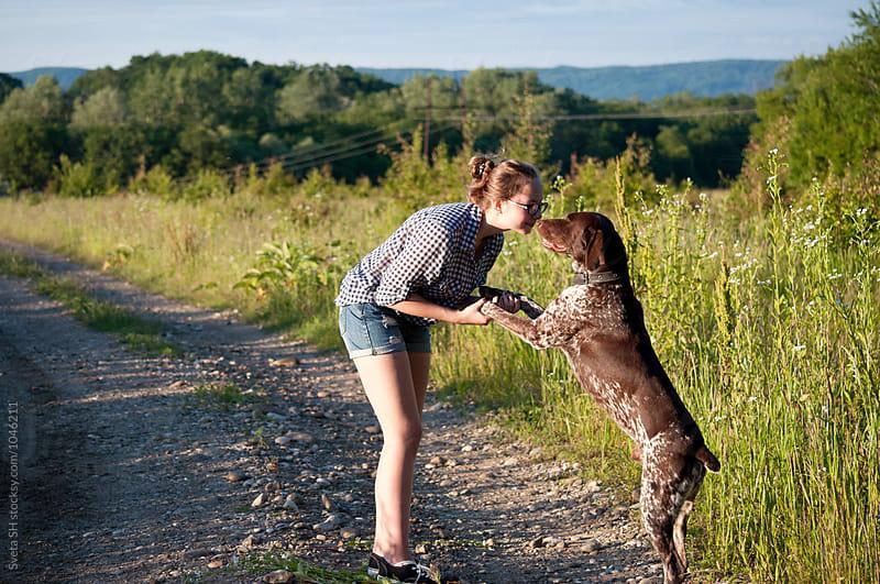 The girl and her hunter dog by Svetlana Shchemeleva for Stocksy United