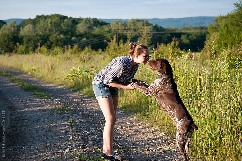 The girl and her hunter dog by Sveta SH for Stocksy United