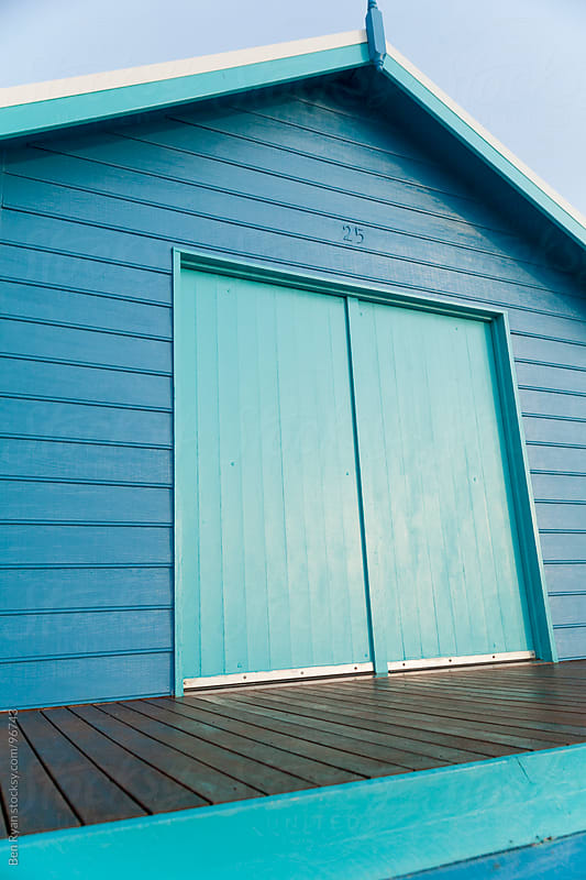 Blue and turquoise weatherboard beach hut by Ben Ryan for Stocksy United