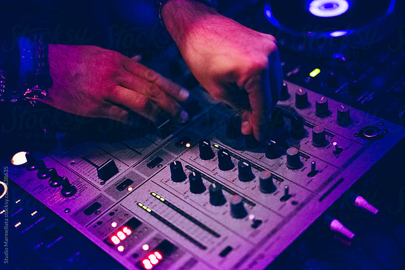 DJ set: DJ hands and DJ desk by Juri Pozzi for Stocksy United