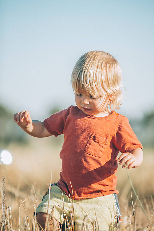 A child walking for the countryside by Lydia Cazorla for Stocksy United