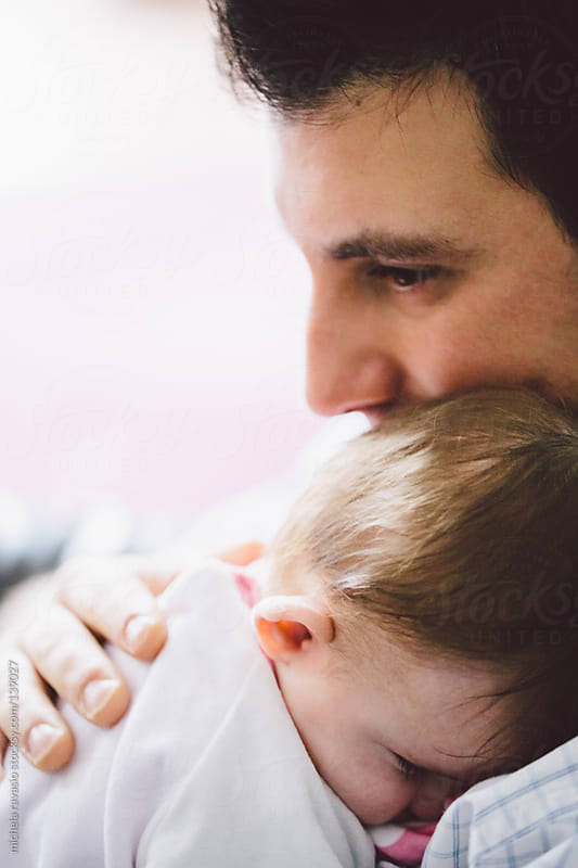 Father and his child by michela ravasio for Stocksy United
