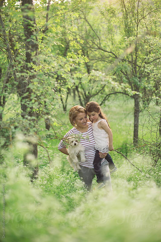 Mother and daughter in spring nature by Dejan Ristovski for Stocksy United