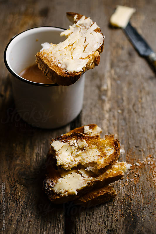 Breakfast: Sweet tea and toast with butter. by Darren Muir for Stocksy United