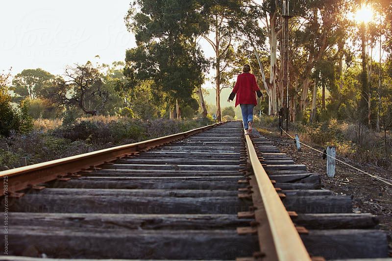 walking on train tracks by Joaquim Bel for Stocksy United