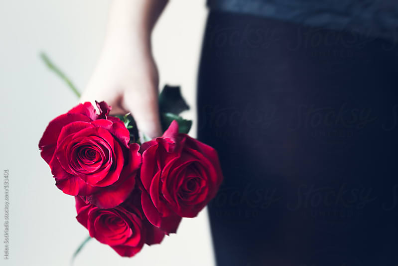 Red Roses by Helen Sotiriadis for Stocksy United