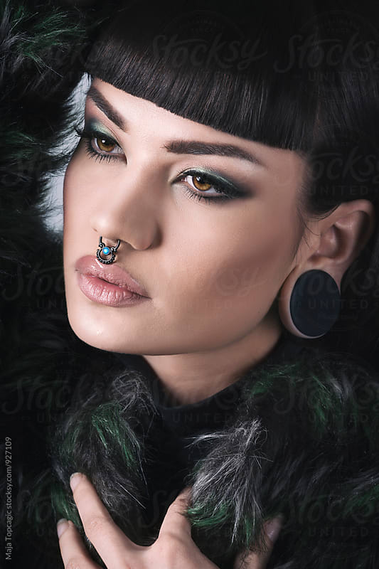 Portrait of a  beautiful woman wearing a septum by Maja Topcagic for Stocksy United