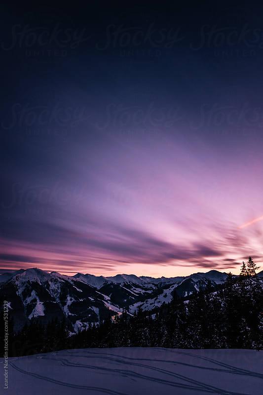 snowcovered austrian alpine winter landscape at sunset by Leander Nardin for Stocksy United