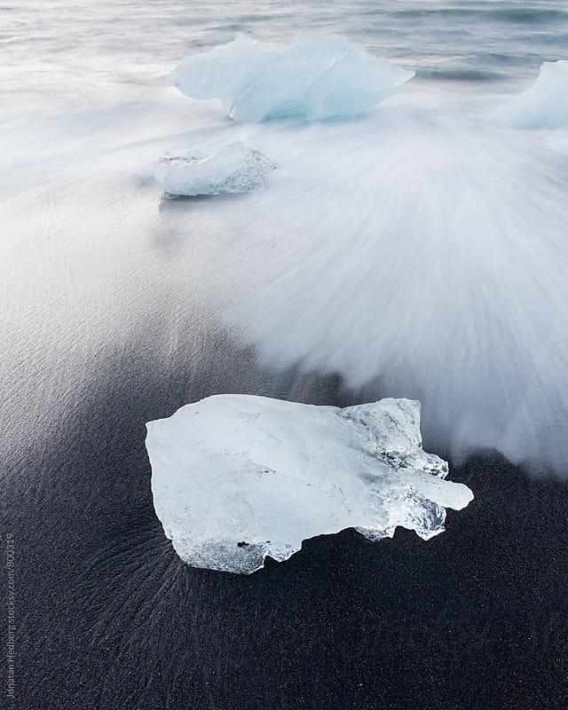Blocks of ice on a black sand beach by Jonatan Hedberg for Stocksy United