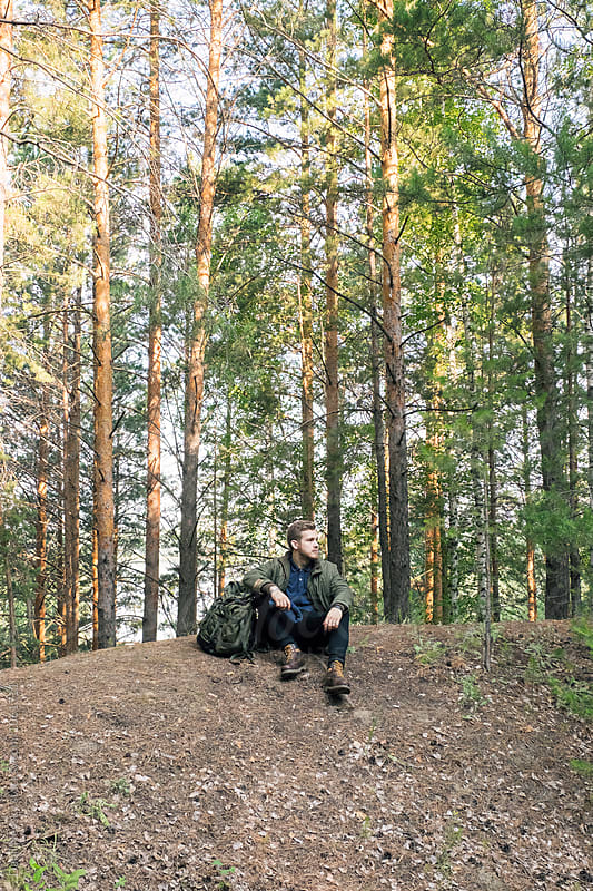 young traveler with backpack in forest by Danil Nevsky for Stocksy United